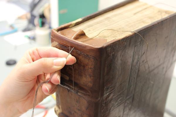 Garret Godfrey binding saddle stitched endband