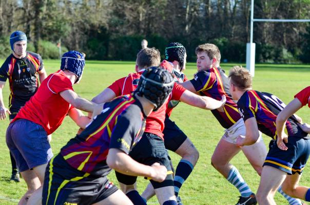 Students playing rugby in the College's sports field next to Leckhampton