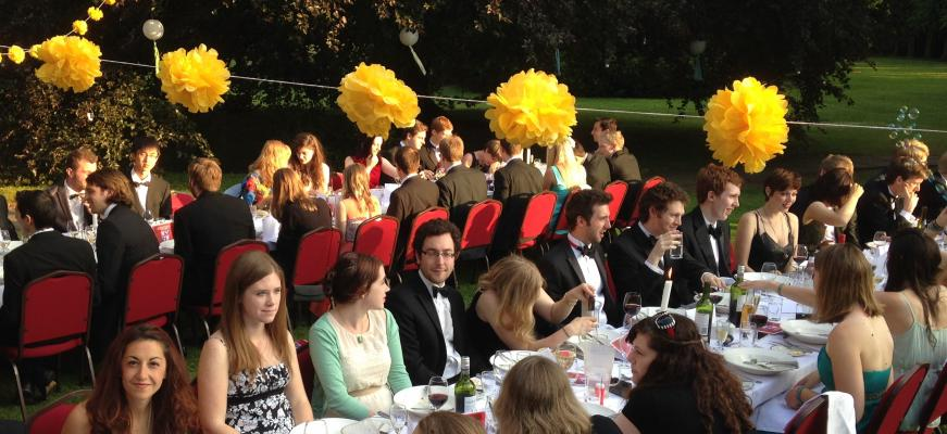 Graduate students at their end-of-year dinner in Leckhampton garden